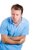Man doubling over in stomach pain — Stock Photo