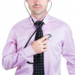Business person listening to his heart with stethoscope — Stock Photo #30337695