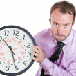 Leader holding a clock, very determined, pressured by lack of time — Stock Photo #30337767