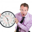 Leader holding a clock, very determined, pressured by lack of time — Stock Photo