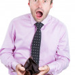 Shocked, surprised speechless man holding an empty wallet — Stock Photo #30337785