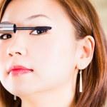 Close-up of a woman applying mascara — Stock Photo