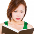 Young beautiful woman surprised by the story she is reading  — Stock Photo