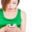 Beautiful womreading sms on her mobile phone — Stockfoto #30339177