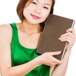 retrato de um estudante feliz segurando um livro — Foto Stock