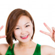 Happy excited young woman showing the sign of victory — Stock Photo