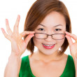 A young woman happy holding showing her new glasses — Stock Photo
