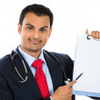 Stock Photo: Doctor holding a clipboard with a consent form for a patient to sign