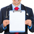 Stock Photo: Doctor holding clipboard with consent form for patient to sign