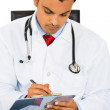 A thoughtful male doctor taking patient notes — Stock Photo