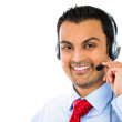 A male customer service operator wearing a headset  — Stock Photo