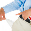 Man pulling out empty pocket — Stock Photo