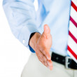 Half-portrait of man extending hand for handshake — Stock Photo