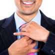 A smiling executive adjusting his pink tie — Stock Photo