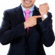 A close-up portrait of a businessman pointing at his watch — Stock Photo