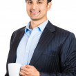 A close-up portrait of a young happy executive having his coffee — Stock Photo