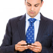 A portrait of a businessman texting on his phone. — Stock Photo