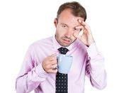 A close-up portrait of a very tired business man — Stockfoto