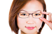 Closeup of woman holding eye glasses frame smiling happy. — Stock Photo
