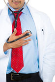 A male doctor listening to his heat with the stethoscope — Stock Photo