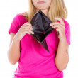 Stock Photo: Girl showing empty wallet