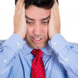 Closeup portrait of really stressed out businessman with headache, wearing blue shirt and pink tie — Stockfoto