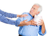 Grandfather holding a piggy bank — Stock Photo