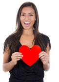 Woman holding a heart — Stockfoto