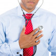 Business person listening to his heart with stethoscope — Stock Photo