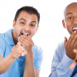 Excited male guys pointing fingers and laughing at you — Stockfoto