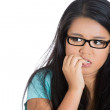 Nervous student with eyeglasses biting fingernails — Stock Photo