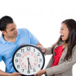 Man and woman fighting over time — Stock Photo