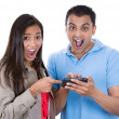 Woman and man looking shocked on a cell phone reading an sms — Foto de Stock
