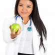 Female doctor or nurse offering you a green apple — Stok fotoğraf