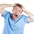 Angry, frustrated man, pulling his hair out — Stock Photo