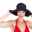 Beautiful woman wearing red bikini and black hat — Stock Photo