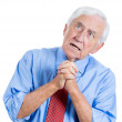 Senior man looking upwards and praying — Stock Photo