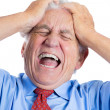 Elderly man with raging headache — Stock Photo