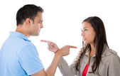 Couple pointing fingers at each other — Stock Photo