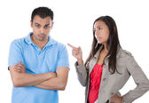 Woman pointing at man as if to say bad boy — Stock Photo