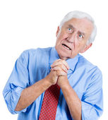 Senior man looking upwards and praying — Stock Photo