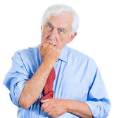 Desperate, mad, crazy looking man, biting his fist — Stock Photo