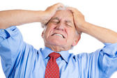 Elderly man with raging headache — Stock Photo