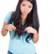 Stock Photo: Surprised girl holding empty wallet