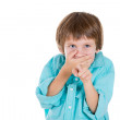 Boy pointing and closing mouth — Stock Photo