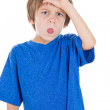 Kid gesturing loser sign — Stockfoto