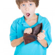 Boy holding empty wallet — Stock Photo