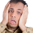Shocked and stressed guy with hands on face — Stock Photo