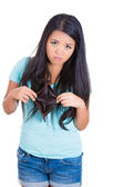 Surprised girl holding an empty wallet — Stock Photo