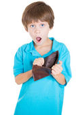 Boy holding empty wallet — Stock Photo